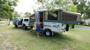 Ashleigh, in front of her and her husband Anthony's pop-up trailer / home.