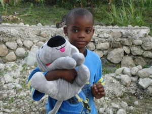 Trouble the Dog with a little boy in Haiti