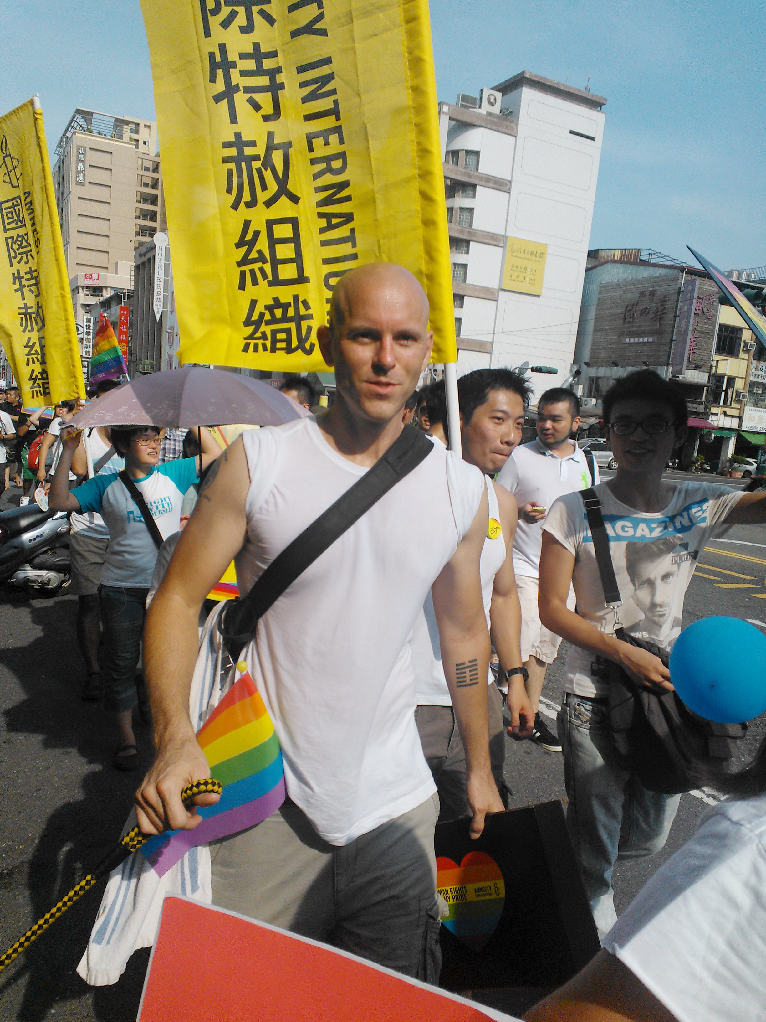 Andrew Bliss marching with Amnesty International in Kaohsiung's gay pride parade.