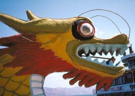 The head of a dragon boat graces a lake in Yunan.