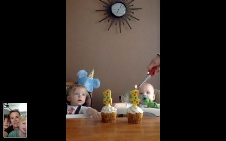 Liz and her children on Skype celebrating the twins first birthday.